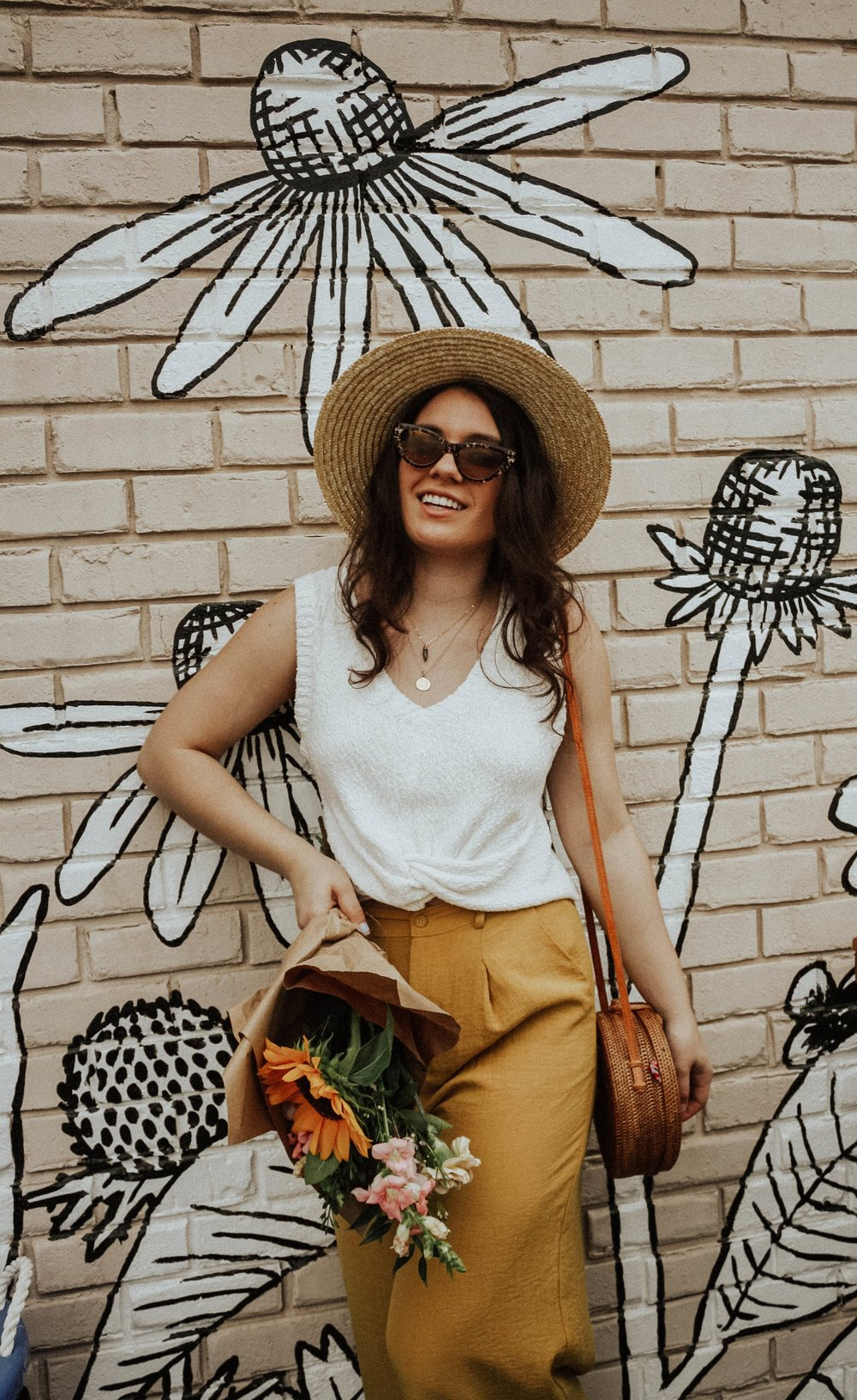 Hat: Lack of Colors; Sunglasses: Amuse Society X D'Blanc; Top: Moon River; Pants: Lost + Wander;Purse: Cleobella; Jewelry: M+M Couture Designs