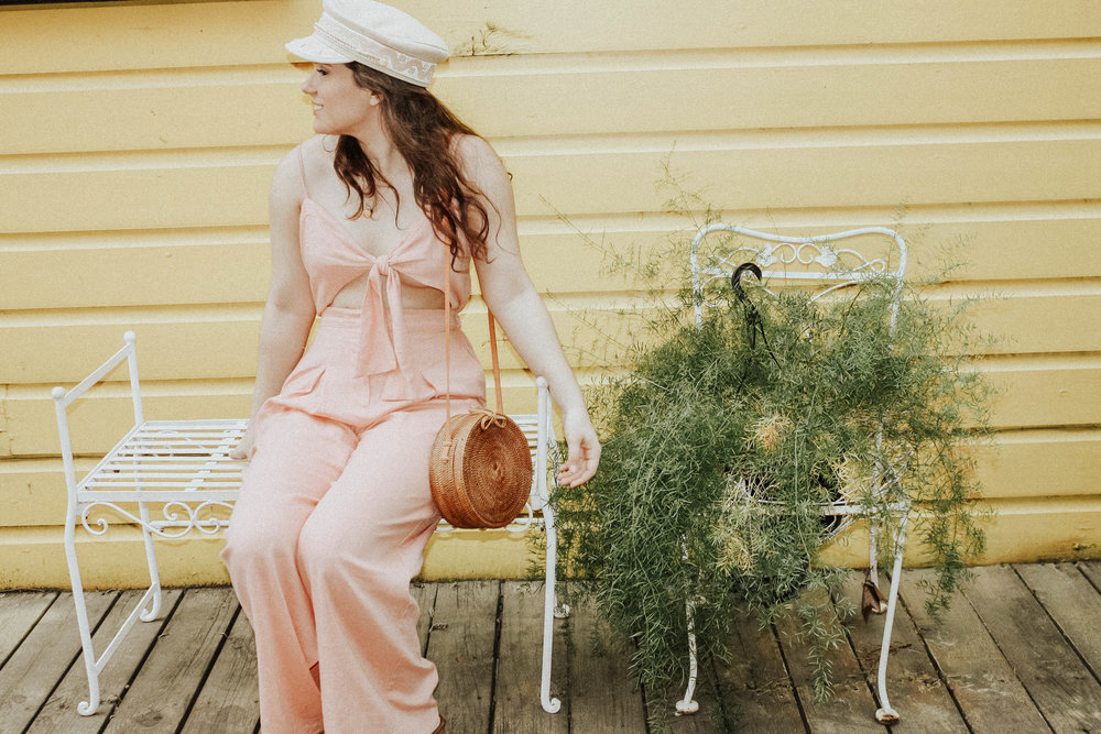 Jumpsuit: Moon River; Purse: Cleobella; Hat: Lack of Colors