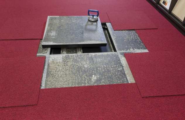 Doppelbodensanierung Düsseldorf Versicherung Doppelboden aus Holzwerkstoff.jpg