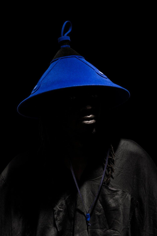 Tigande Hat - Black Background Blue Hat 1.jpg