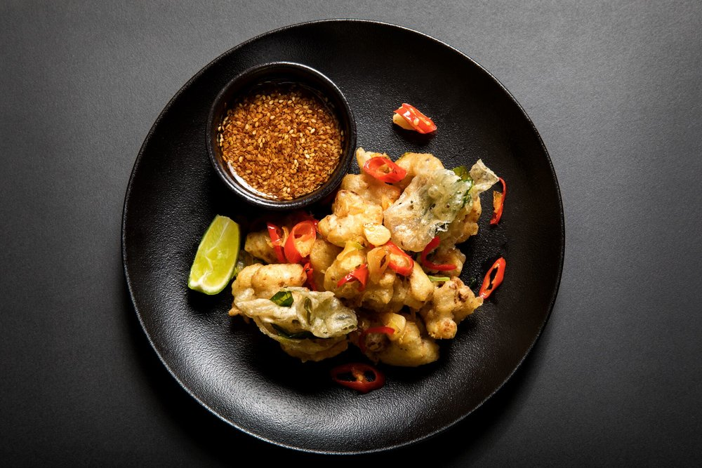 Worth visiting for this alone! All hail Ravinder's Cauliflower Popcorn, Thai Basil Tempura, Black Vinegar and Chilli Dip