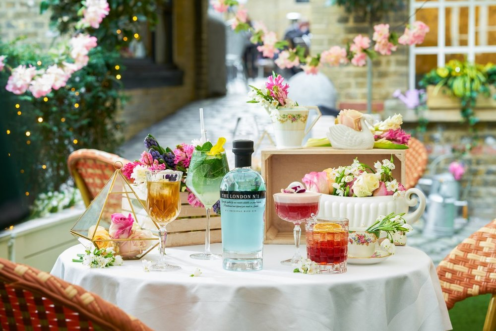 Hush_LondonInBlossom_Cocktail+Group+&+Courtyard_preview.jpg