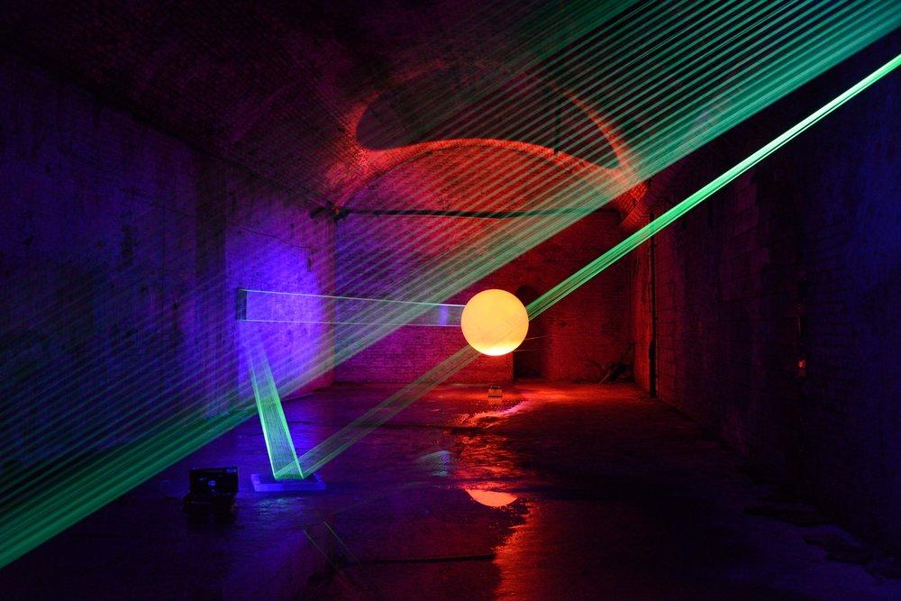 David Ogle,  08019 , detail, fluorescent fishing line, ultraviolet light, weather balloon and red halogen light, Image credit A K Purkiss