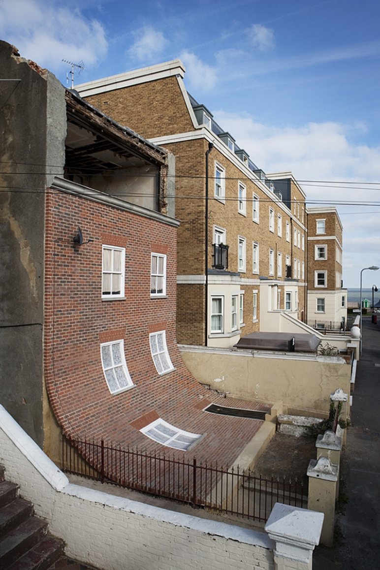Alex Chinneck,  From the knees of my nose to the belly of my toes , 2013, brick, steel, plywood, pine, polycarbonate, EPS Foam, concrete and fibreglass, dimensions variable