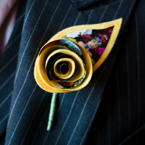 comic swirl buttonhole with felt leaf.png