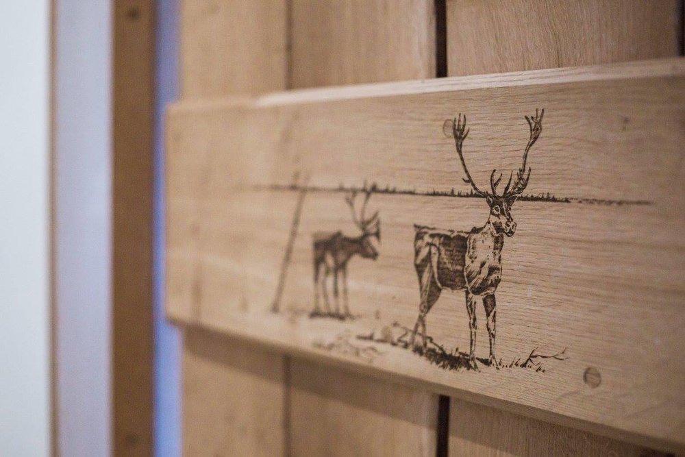 Pyrography reindeer on oak door