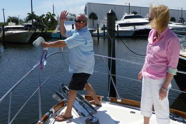 "Jerome ""Buzz"" and Marcia Howe are extremely excited during the christening of their 2005 Grand Banks 43 Eastbay HX, ""KENZIE"" on June 17 at the HMY docks in Harbour Towne Marina, Dania, FL. The Howe's plan to cruise South Florida waters and the Bahamas."