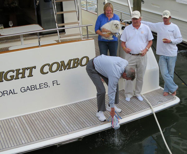 Owners Norman and Jody Powell christen their 2011 Grand Banks 53 Aleutian RP, THE RIGHT COMBO, with their son, Casey Powell and beloved Salty Dog. The christening took place on February 2, at the HMY docks in Harbour Towne Marina, Dania, FL.
