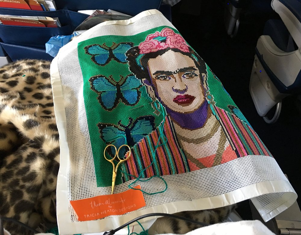 On my flight from Charleston to Sarasota. Frida is my traveling buddy. I was listening to the Woodstock soundtrack and struggling not to sing aloud.