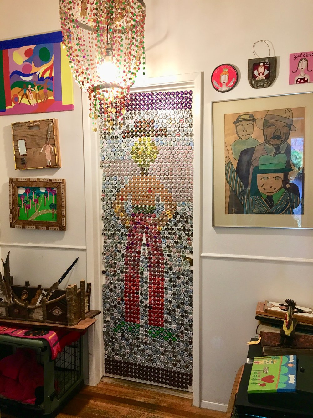 A cowboy graces the powder room door.....styled with bottle caps!!
