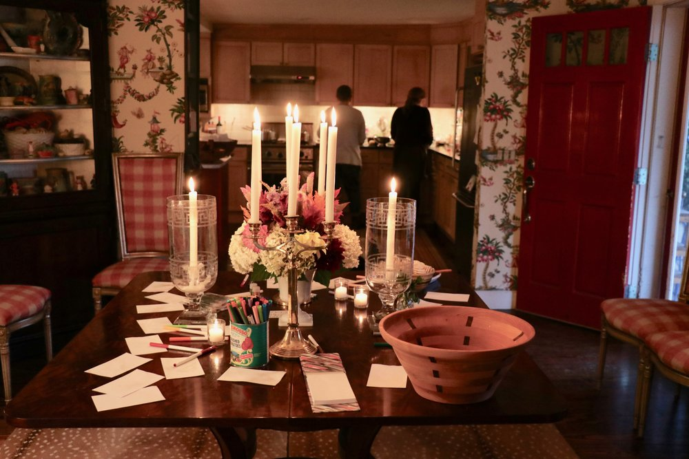 While Amy and Lauren put the finishing touches on a gourmet vegetarian dinner in the kitchen, guests are invited to fill the bowl with written dreams, thoughts of gratitude, prayers, or wishes.