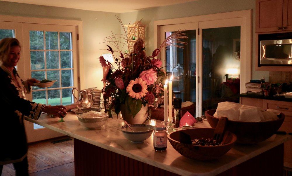 Our hostess setting the island buffet.