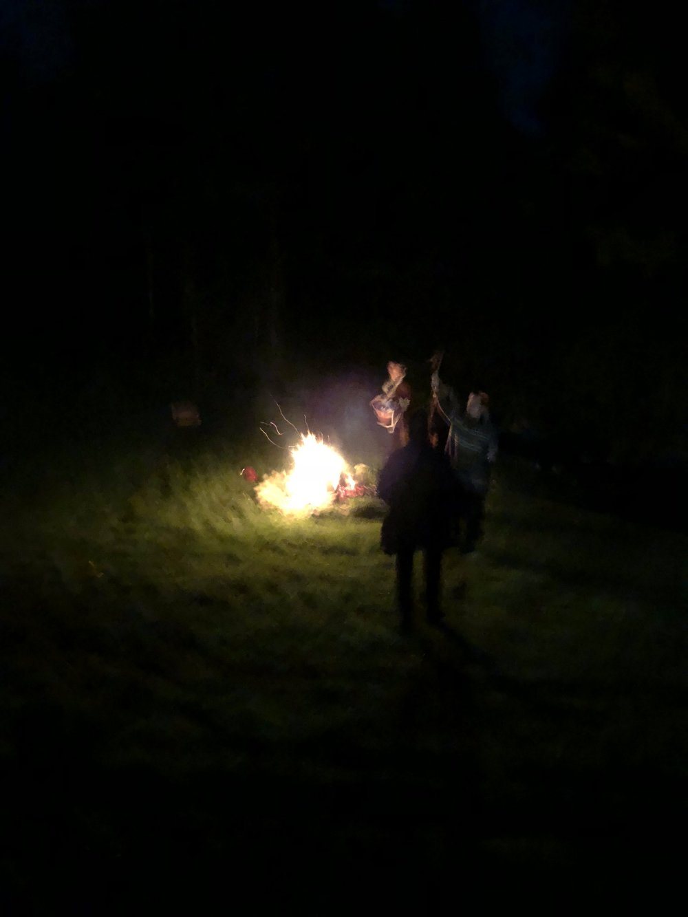 A fire by the stream is the perfect setting for women to gather.