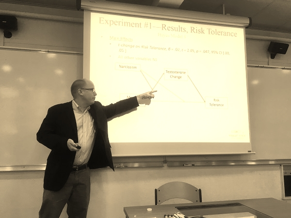 Giving a research presentation on consumer risk tolerance at HEC Paris.