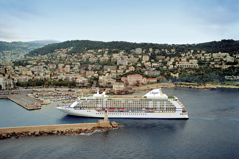 Cruise ship sailing into a Mediterranean port city