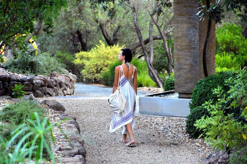 Woman walking on garden path at Auberge du Soleil