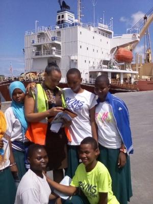 Students at the Dar Es Salaam port with the staff; kneeling, (from L-R standing) Maria John Kwanga and Stella Mswakala at the back (from L-R) Amina Zuberi, Amina Kiondo and Neema John.