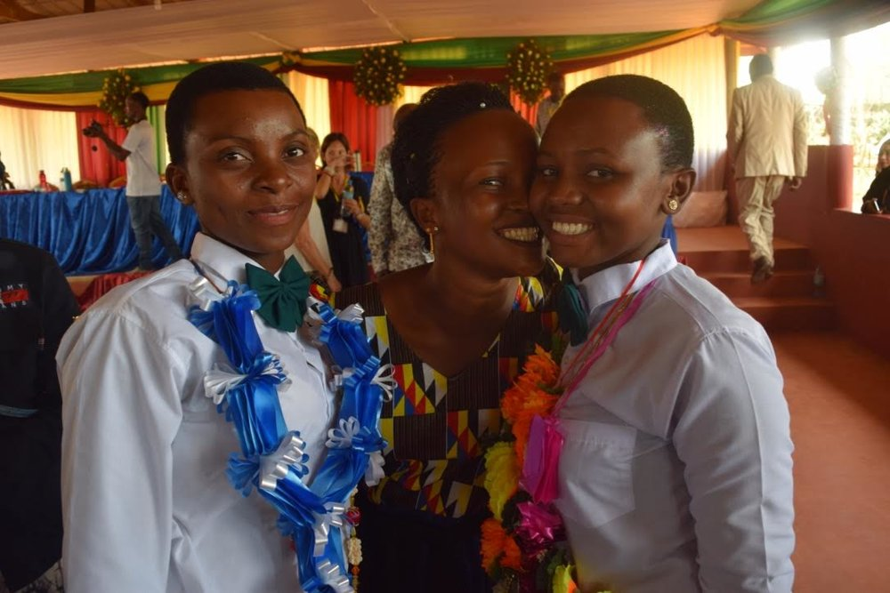 Form 4 Graduates with Relatives -- Jacqueline and Amina.jpg