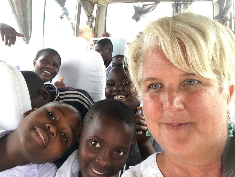 Tina Johnson with SEGA students on a field trip.