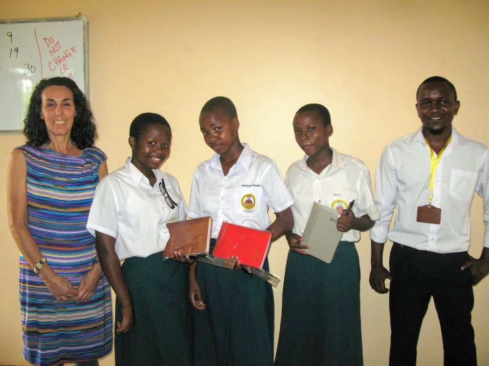 Touch typing winners with their Teachers, Cindy Tarpo (ICT Technical advisor- Volunteer) and Fadhili Makunga (IT Coordinator). The girls were awarded notebooks and pens.