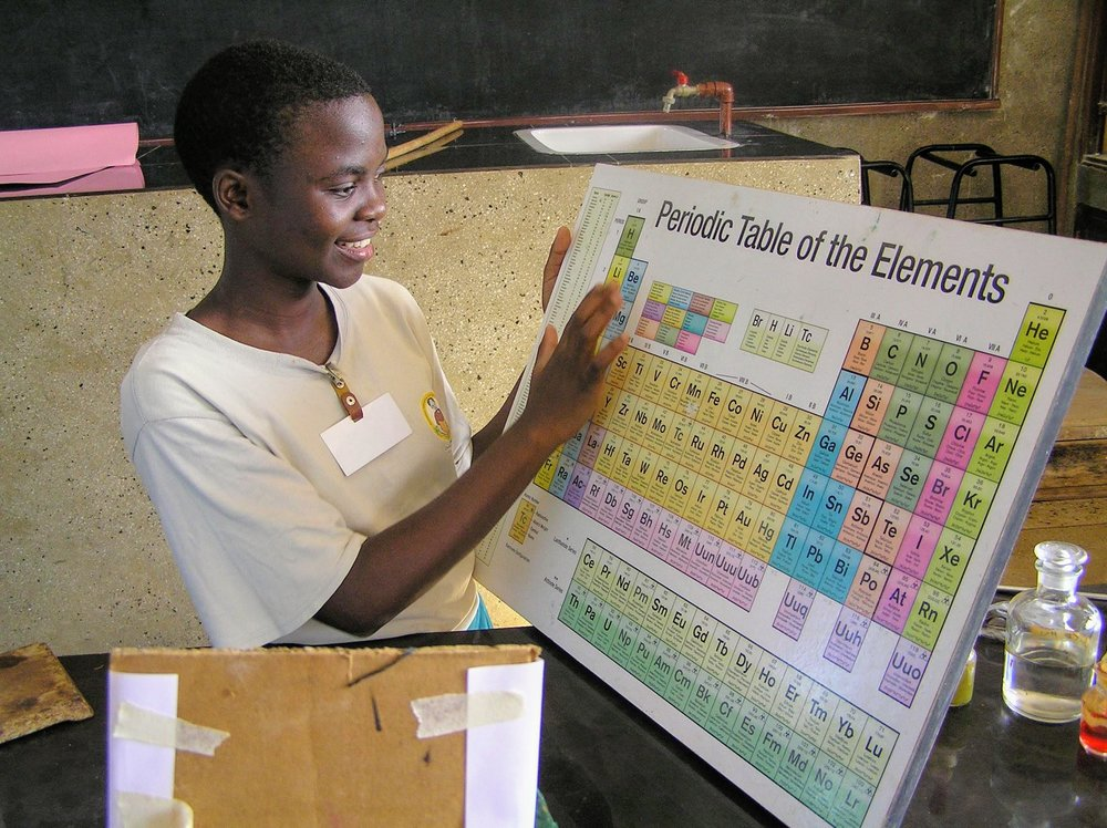 Caroline Samson Mkunda Form 3 practicing the periodic table.
