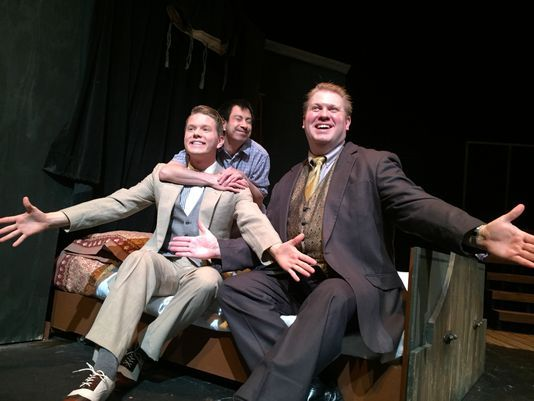 "The Man in the Chair (Peter Kao) hugs Robert (Benjamin Johnson) performing in the Man's favorite musical along with George (Michael Skocir, right) in a scene from Waukesha Civic Theatre's ""The Drowsy Chaperone."" (Photo: WCT/submitted)"