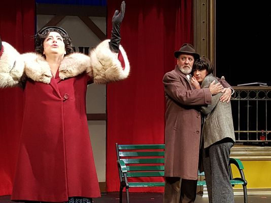 """Rose (Kelli Cramer) sings """"Everything's Coming Up Roses"""" on a railroad platform while Herbie (John Kramer) and Rose's daughter Louise (Megan Miller) comfort each other in a scene from """"Gypsy"""" at Waukesha Civic Theatre. (Photo: Submitted)"""