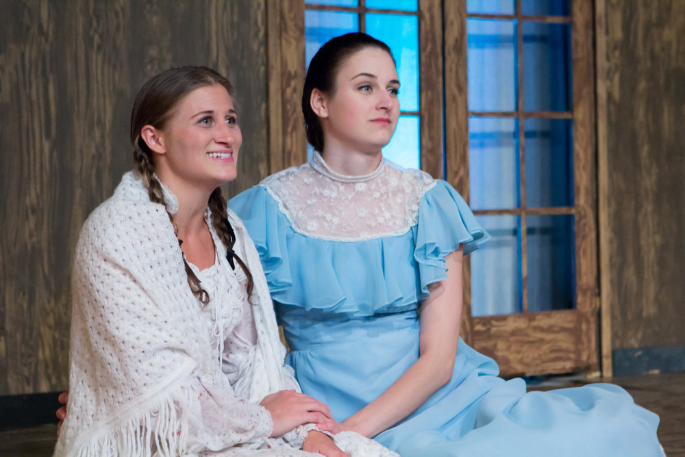 "Courtney Denzer as ""Beth March"" and Kat Geertsen as ""Jo March"" in 'LITTLE WOMEN' at Lake Country Playhouse. Photo credit: James Baker"