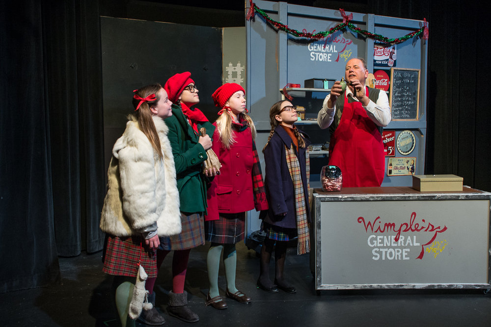 "School mates Carla Mae (Katherine Rogers), Judy (Vanessa Ruck, Susan (Grace Munson) and Addie (Julia Rady) visit Frank Wimple (Paul Lipinski) at his general store to purchase a gift for their teacher in a scene from Waukesha Civic Theatre's ""The House Without a Christmas Tree."""