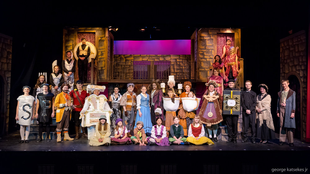 """Stephanie Staszak as Belle, center, is flanked by Tom Marks, left, who plays her father, and Keith R. Smith, right, who plays the Beast/Prince as well as the entire cast of Sunset Playhouse's """"Disney's Beauty and the Beast."""""""