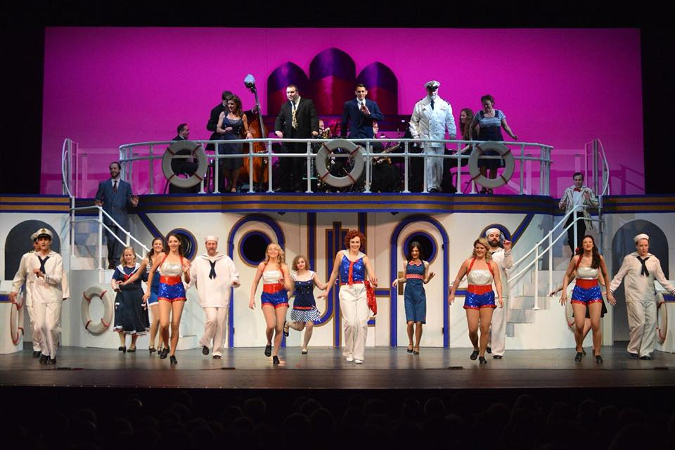 "Reno (Morgen Aria Clarey), center, leads her Angels and others in a snappy dance routine in a scene from Falls Patio Players ""Anything Goes."""