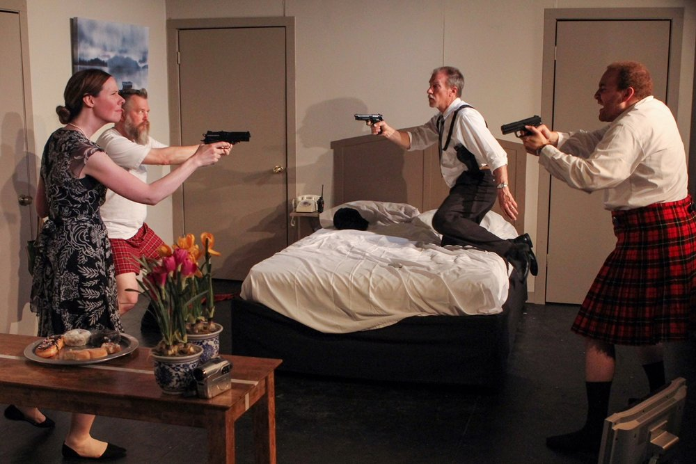 "Mrs. Meekly (Jen Anderson), from left, Todd (Terry Haller), Agent Frank (Paul Weir) and Eric (Matthew Scales) play cat-and-mouse with their firearms in a scene from Lake Country Playhouse's ""Unnecessary Farce."""