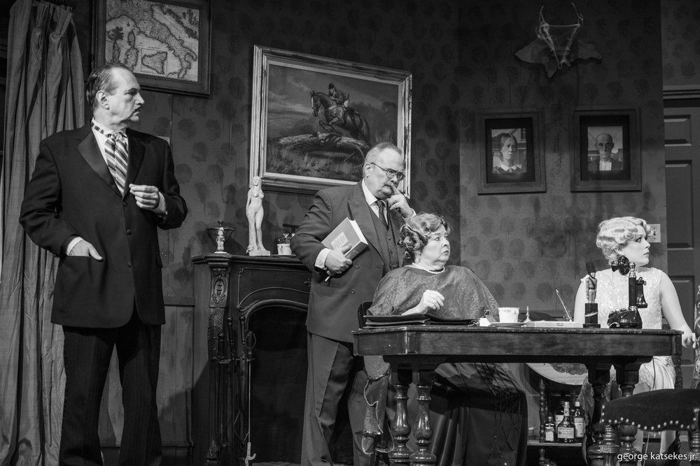 """Lawyer Roger Masters (Glenn Villa), Hannibal Hix (Hal Erickson), Ernestine Wintergreen (Diane Kallas) and Sally VanViller (Megan Tappan) gather at an old isolated mansion in a scene from Sunset Playhouse's """"Any Number Can Die."""""""