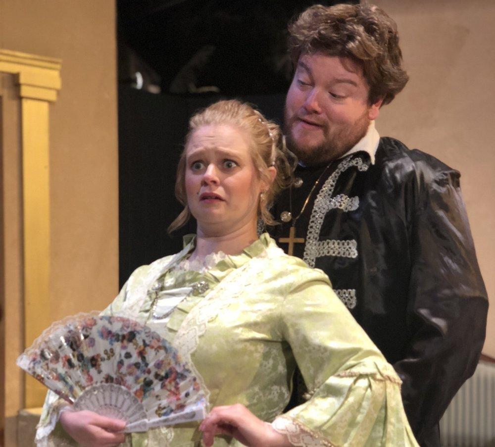 "Elmire (Ruth Arnell) is startled by the bold advances of Tartuffe (Nicholas Callan Haubner) in a scene from SummerStage's ""Tartuffe."""
