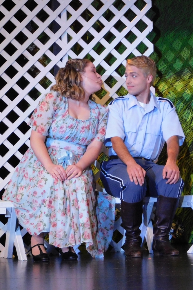 "Liesl (Sarah Melcher) tries to steal a kiss from Rolf (Joseph Gall) in the ""Sixteen Going on Seventeen"" scene from West Community Theatre's ""The Sound of Music."""