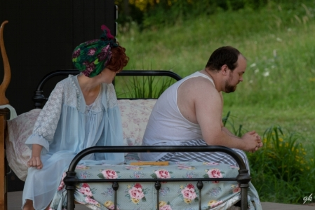 """Jessie Mae (Emerald Klauer) and Ludie Watts (Logan Milway) argue in their apartment bedroom in a scene from SummerStage's """"The Trip to Bountiful."""""""