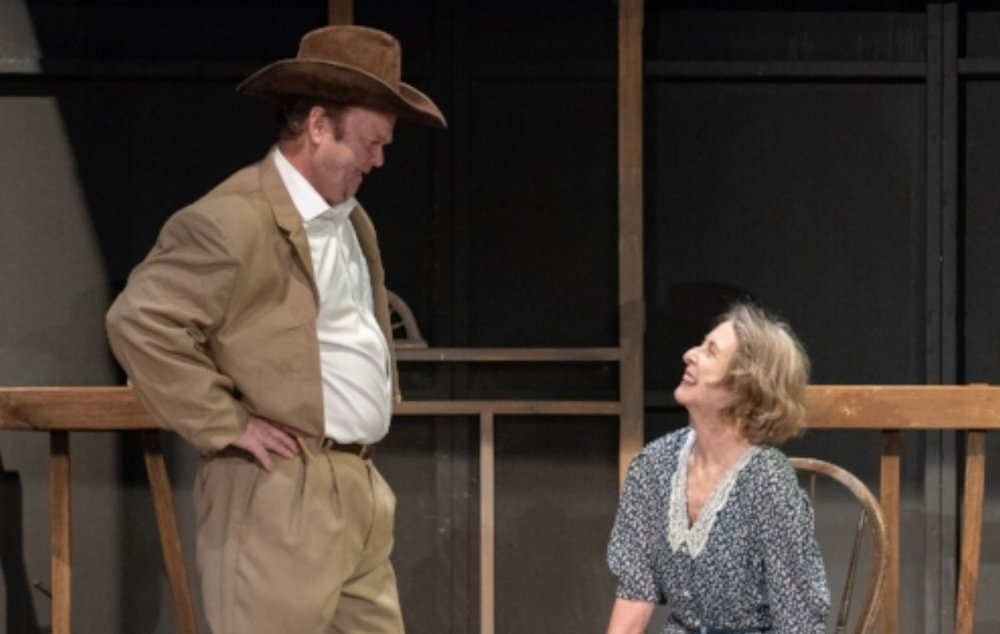 """Carrie Watts (Mary Atwood) talks to the Sheriff (Jamie Ryan) after he drives her to her hometown of Bountiful, which has turned into a ghost town, in a scene from SummerStage's """"The Trip to Bountiful.""""  Photos by George Katsekes"""