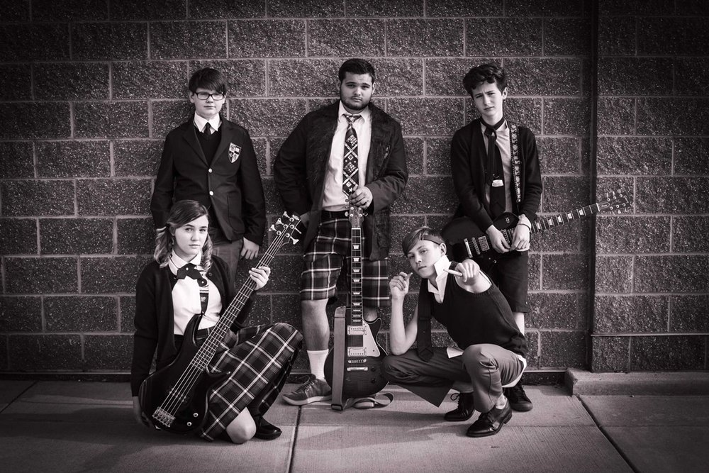"Members of the School of Rock band strike a pose befitting their rock star status in ""The School of Rock,"" presented by Sudbrink Publications. Pictured are, from left top, Lawrence (Ryan Vanselow), Dewey (Thomas Madrzak), Zack (Cian Radcliffe), bottom, Katie (Ivy Broder) and Freddy (Zander Tomes)."