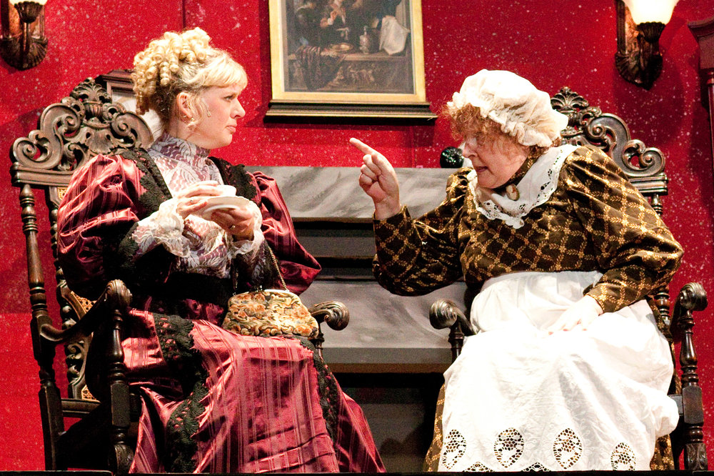 """Mrs. Hudson, right, (Gailmarie Haller) gives Lizzie Chapman (Kelly Simon) an earful when she visits Miss Holmes in a scene from Falls Patio Players """"Miss Holmes.""""  Photos by Lisa Majkrzak, Artan Sol Photography"""