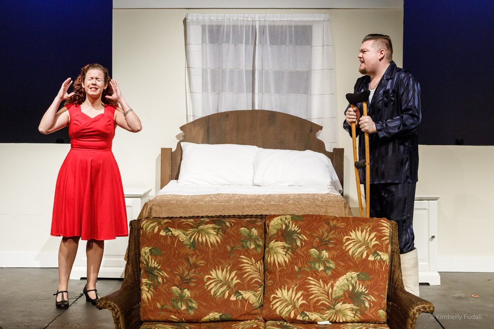 "Maggie (Avidalis Hurst) and her husband Brick (Nicholas Callan Haubner) argue during a birthday party for Brick's father at his father's southern plantation in a scene from West Allis Players' ""Cat on a Hot Tin Roof."""
