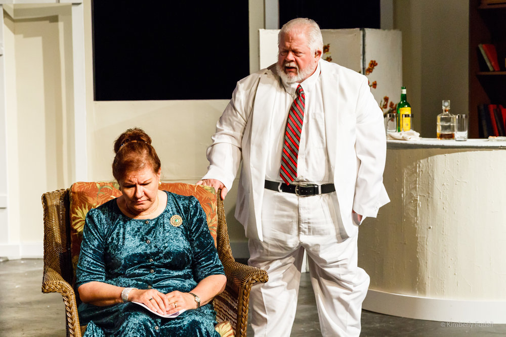 "Big Mama (Katherine Beeson) and Big Daddy (Gene Schuldt) converse in a bedroom of their estate in a scene from West Allis Players' ""Cat on a Hot Tin Roof."""