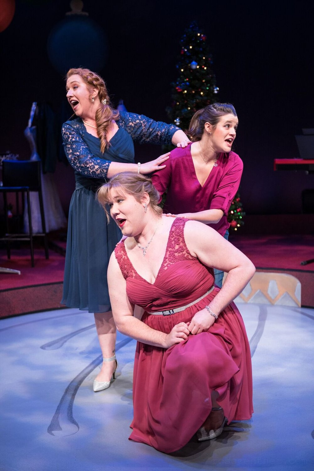 """Marcee Doherty-Elst, top left, Susie Duecker, top right, and Kelly Doherty sing a tune in Next Act's """"The 12 Dates of Christmas."""""""