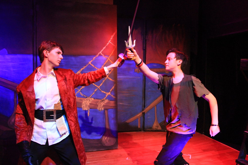 "Captain Hook (Jack Rankin, left) does battle with Peter Pan (Gabriel Hagedorn) in a scene from The Box Theatre Co.'s ""Disney's Peter Pan Jr."""
