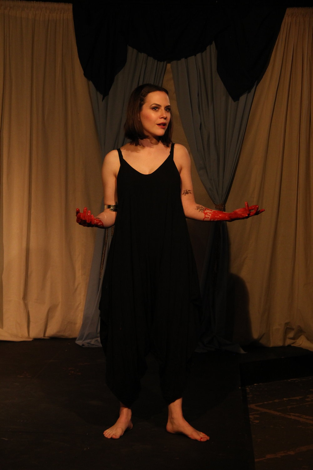 Medea (Cara Johnston) rationalizes her evil deed in Voices Found Repertory's production.