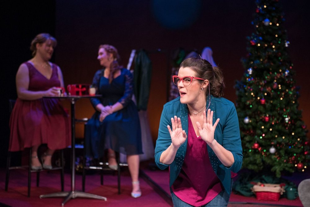 "Mary (Susie Duecker) imitates her Aunt Mary in a scene from Next Act Theatre's ""12 Dates of Christmas."""