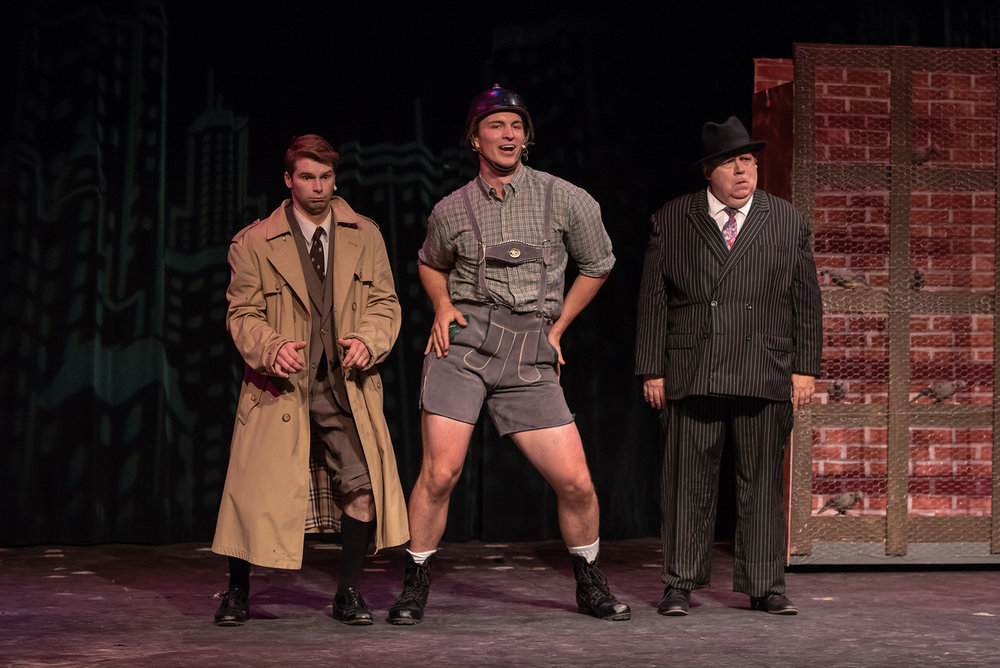 "Leo Bloom (Zach Zembroski, left) and Max Bialystock (Robert Zimmerman) meet up with the eccentric German playwright Franz Liebkind (Steven Sizer) in a scene from Sunset Playhouse's ""The Producers."""