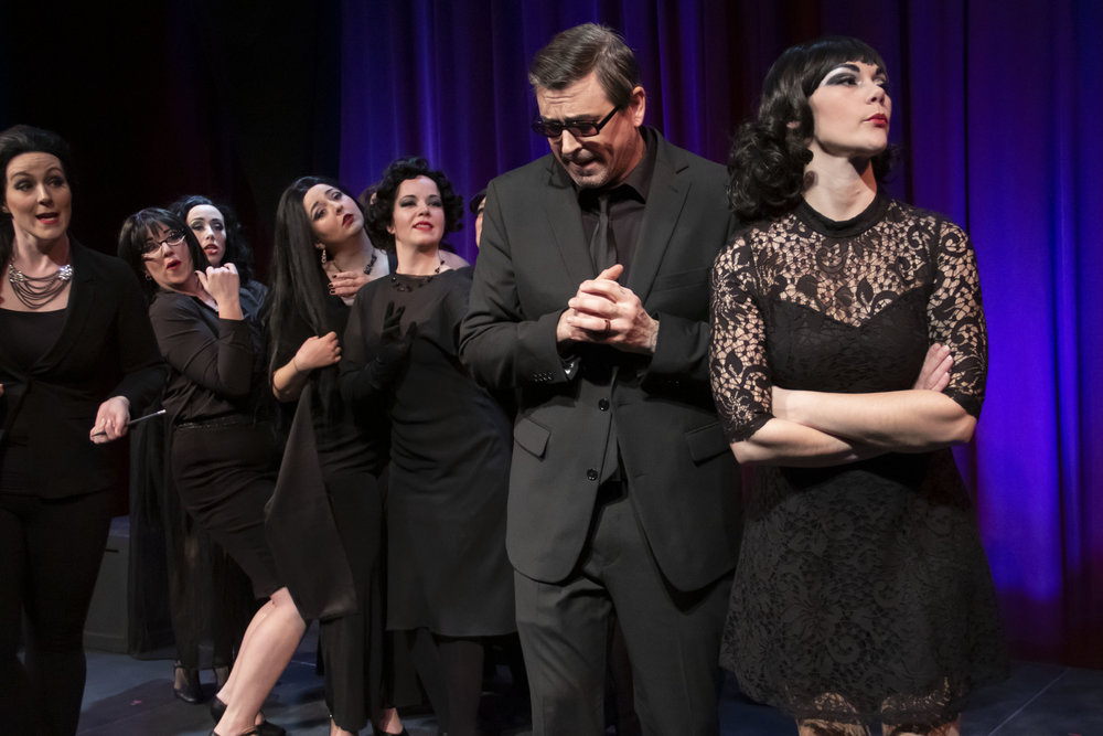 """Guido (Timothy J. Barnes) has a hard time juggling all the women in his life including, from left, Lina (Carrie Gray), Stephanie (Marcee Doherty-Else), Carla (Samantha Sostarich), Our Lady of the Spa (Hannah Esch), Guido's Mother (Laura McDonald) and Luisa (Rae Elizabeth Pare) in a scene from Theater Red's """"Nine."""""""