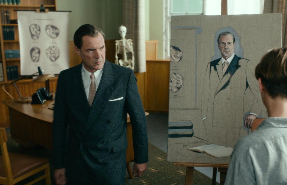 """Kurt Barnert (Tom Schilling) paints a portrait of Professor Seebrand (Sebastian Koch) in a scene from """"Never Look Away."""""""
