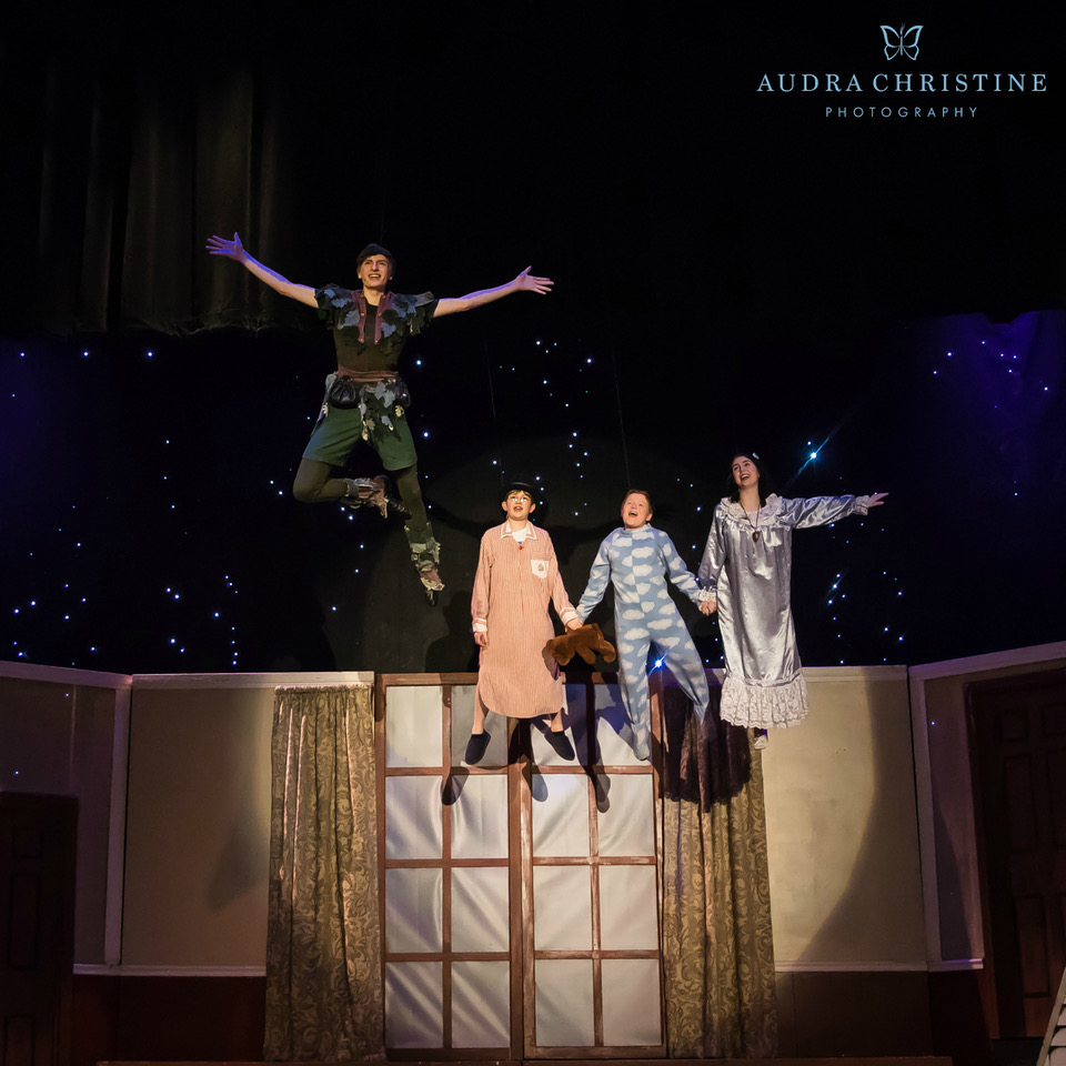 """Peter Pan (Nathan Walla) teaches the Darling children, from left, John (Cavan Fuller), Michael (Jonathan Doome) and Wendy (Ariel Marks) in a scene from Christian Youth Theater's """"Peter Pan.  Photos by Audra Christine Photography"""