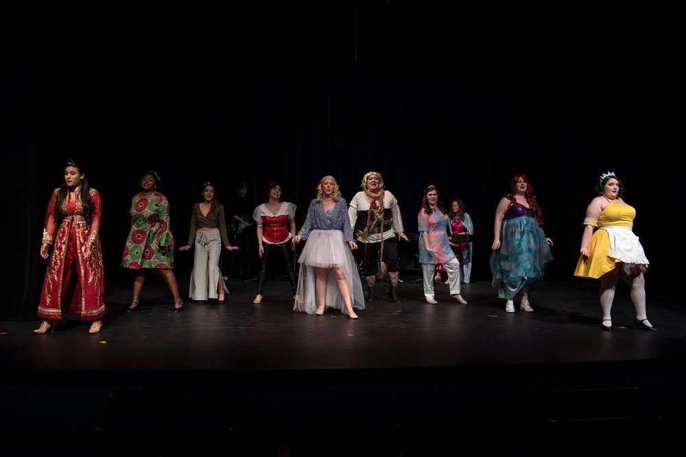 """A bevy of princesses get revenge in Outskirts Theatre Company's """"Disenchanted: The Musical"""" including, from left, Princess Baldroulbadour (Ashley Rodriguez), The Princess Who Kissed the Frog (Ashley Levells), Hua Mulan (Jennifer Clark), Snow White (Samantha Paige), Cinderella (Emma Losey), Rapunzel (Megan B. Wilson), Sleeping Beauty (Gabriella Ashlin), The Little Mermaid (Caitlin Pilon) and Belle (Francesca Steitz). In the back is the Fairy Godmother, music director Julie Johnson."""